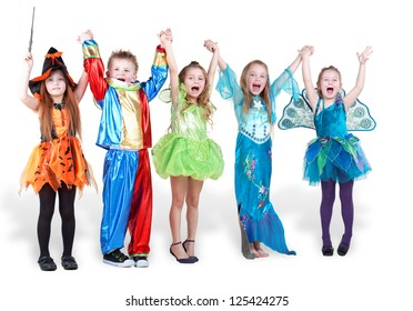 children stand holding hands and lifting them up and shout