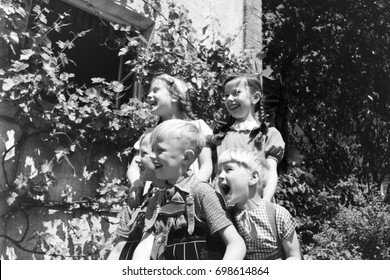 Children standing outdoors laughing