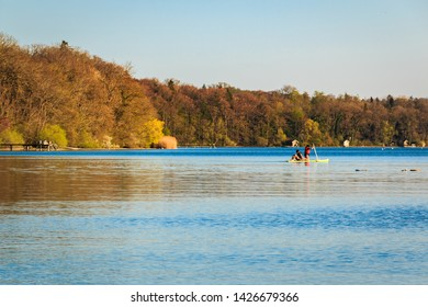 Children at the standing paddling am Ammersee in Bavaria Germany