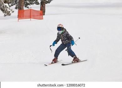 Children starting to learn how to ski. Winter sport. Horizontal