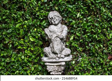 Children statue and green background