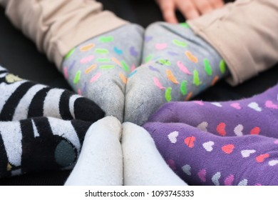 Children stretching their feet together in a circle
