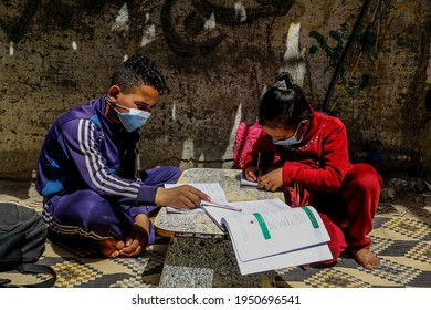 Children study outside their home, after a schools a closed run by the United Nations (UNRWA). Amid new measures to counter the spread of COVID-19 coronavirus, in Gaza Strip, on April 6, 2021.