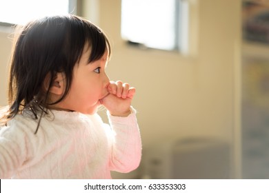Children sucking their fingers