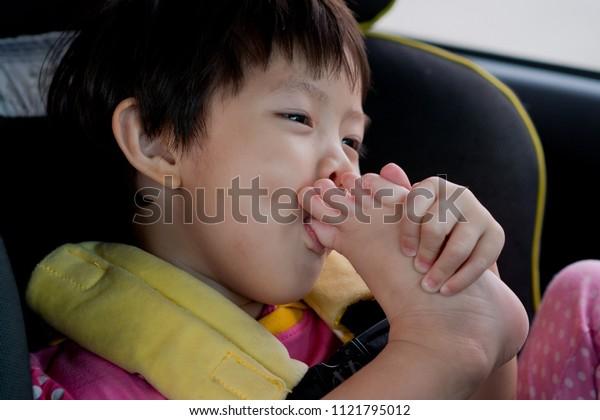 Children sucking a toe