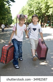 Children with suitcase run. Children tourism.