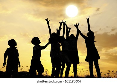 Children and the sun at sunset