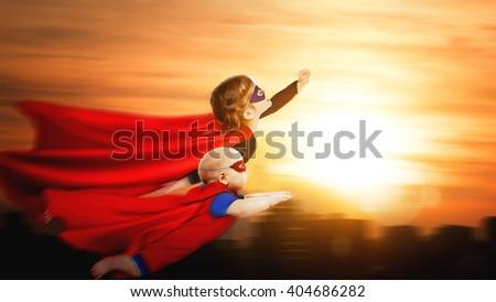 children superheroes flying across