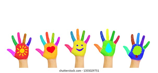Children support the future, environmental protection, care for the Earth. Nature, sun, green, water, love and joy concept. Children's hands painted with symbols.