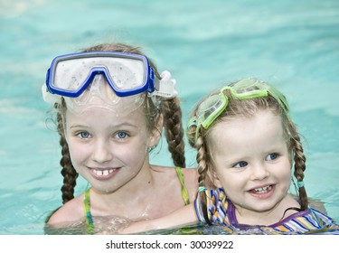 Children swim in swimming pool. Recreational facilities.