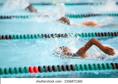 Children swimming in a freestyle race