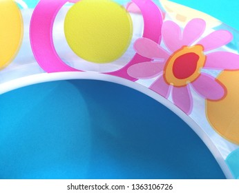 Children swimming inflatable floater in bright colors on blue background flat lay