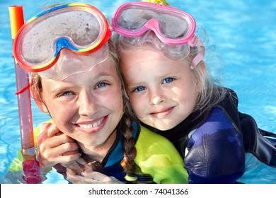 Children in swimming pool learning snorkeling. Sport.