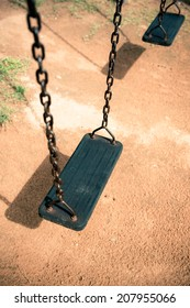 Children swing in the park