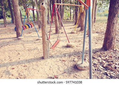 Children swing,playground in the park (vintage tone)