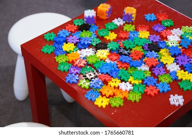 Children table full of building pieces.