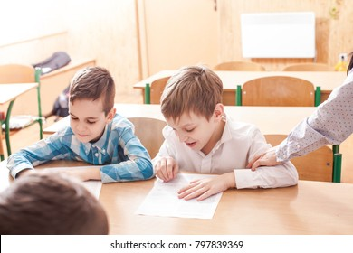 Children taking an exam