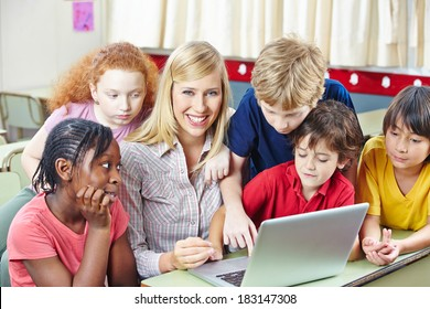 Children with teacher in computer science class in an elementary school