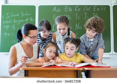 Children with teacher reading a book
