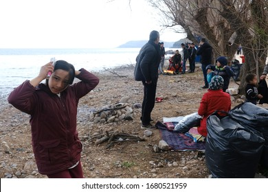 Children with their families wait to be transferred to the port of Mytilene from the village of Skala Sikamias, on the island of Lesbos, Greece, March 4, 2020.