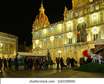 Children with their parents queuing at the 'Maria Pita' square to see Santa Claus Coruna, Galicia, Spain 12/17/2018