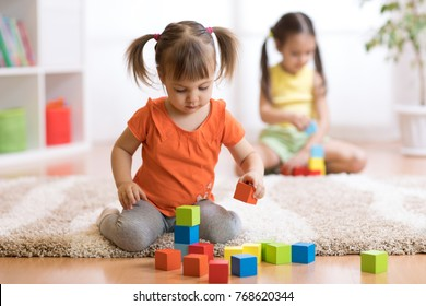Children toddlers girls play toys at home, kindergarten or nursery. - Shutterstock ID 768620344
