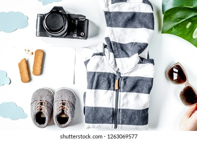 children tourism outfit with clothes and camera on white backgro