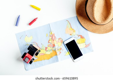 children tourism outfit with map and phone on white background flat lay mockup