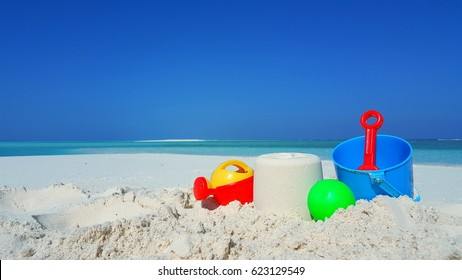 Children toy bucket and space on the sand beach and beautiful sea view with blue sky
