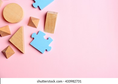 Children toys on pink background