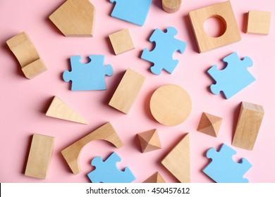 Children toys on pink background
