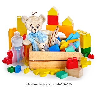 Children toys with teddy bear and cubes. Isolated.