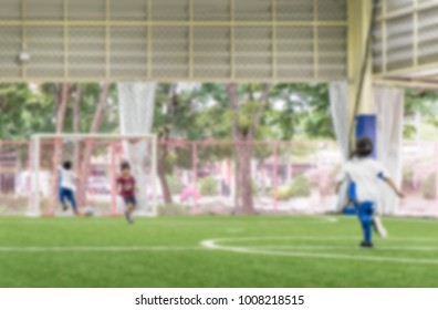 Children training on Soccer field blur for abstract background