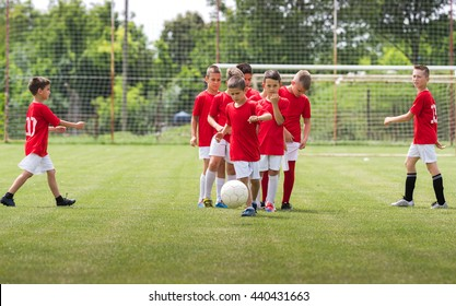 Children Training Soccer in a sport field