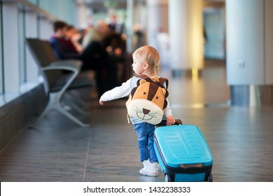 Children, traveling together, waiting at the airport to board the aircraft