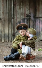 "Children in uniform.Soldiers,the defenders of the Fatherland. ""I remember, I'm proud!"".Military history.defender of Fatherland. Military theme.Military uniform."
