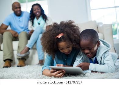 Children using digital tablet at home