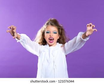 Children vampire makeup kid girl on purple background