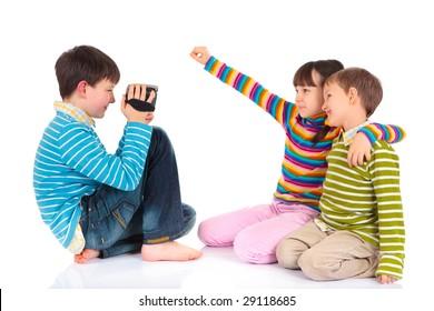 Children with video recorder