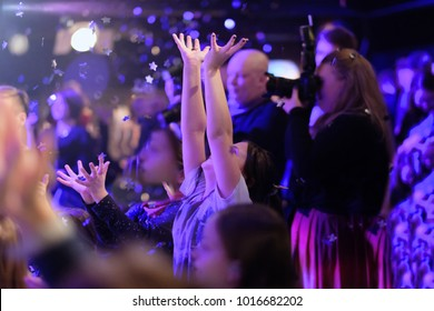 Children viewers with their hands up with joyful emotions at the concert