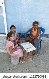 children in the village on the Gran Roque Island at the Los Roques Islands in the caribbean sea of Venezuela.     Venezuela, Los Roques, November, 2018