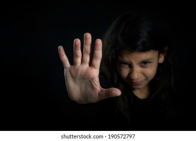 Children violence. Girl with her hand extended signaling to stop.