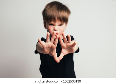 Children violence, Small violence boy showing his hand . Concept of domestic violence and child abusement.