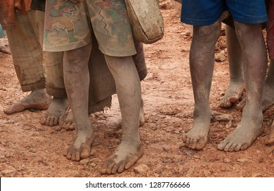 Children walk with barefoot on the dirt road, Laos.