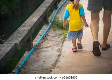 Children walk with mom