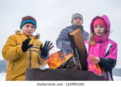 Children warm themselves by the fire on a frosty day, Grodno, Belarus January 20, 2018