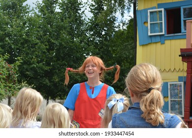 Children watching Pippi Longstocking performance at Astrid Lindgren's World theme park, Vimmerby, Sweden. Children's entertainment. Summer holiday. Space for copy.