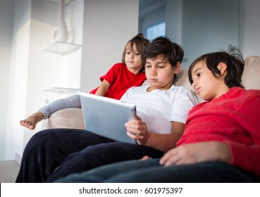 Children watching tablet at home