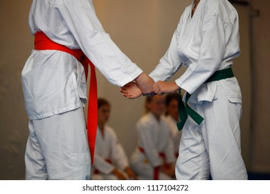 Children in a white kimono during an exercise aikido in the gym