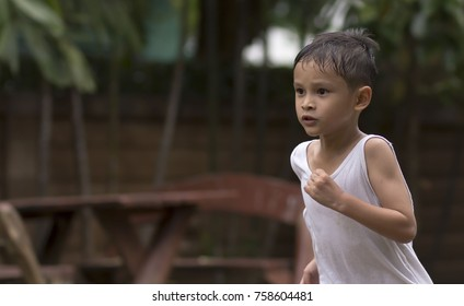 Children in white with sweat on his face on sport